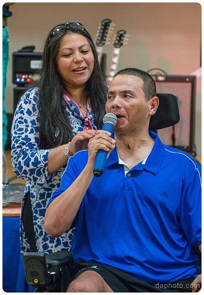 Our 2017 Honoree CPT. Luis Avila singing God Bless America, joined by his wife Claudia